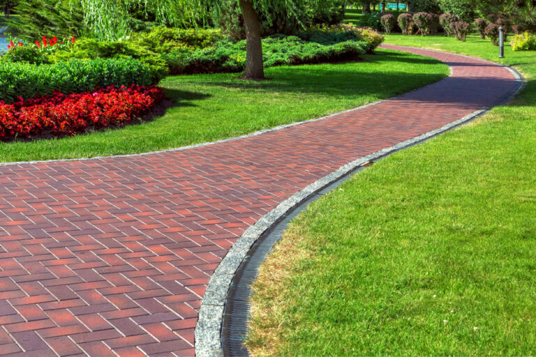 Commercial Drainage System Along Brick Pavement |