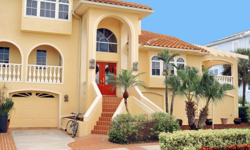 Florida House With Simple Landscaping and Pavers