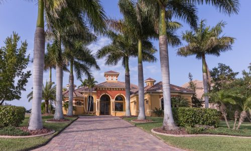 Florida House With Paved Driveway And Palm Trees